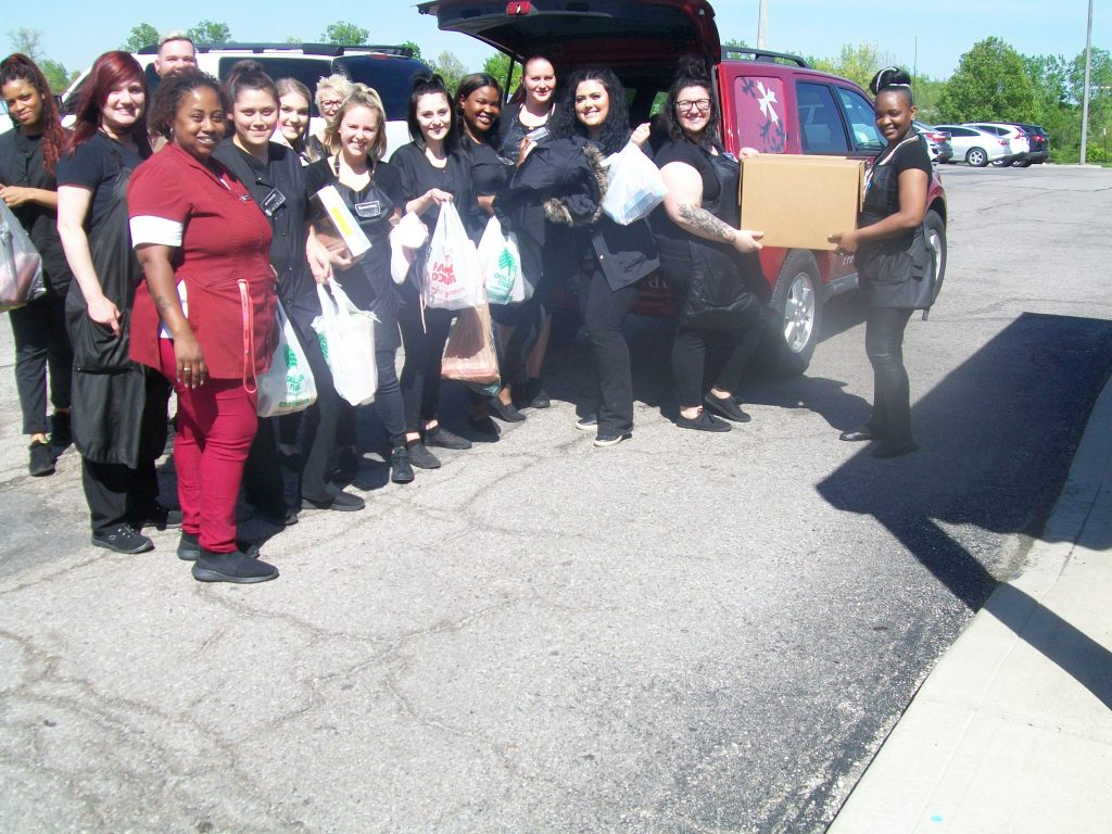 Cosmetology students loading up a vehicle with supplies to be donated to a local Dayton domestic violence shelter.