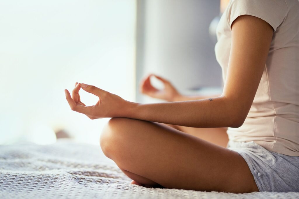 Woman coping with stress through meditation