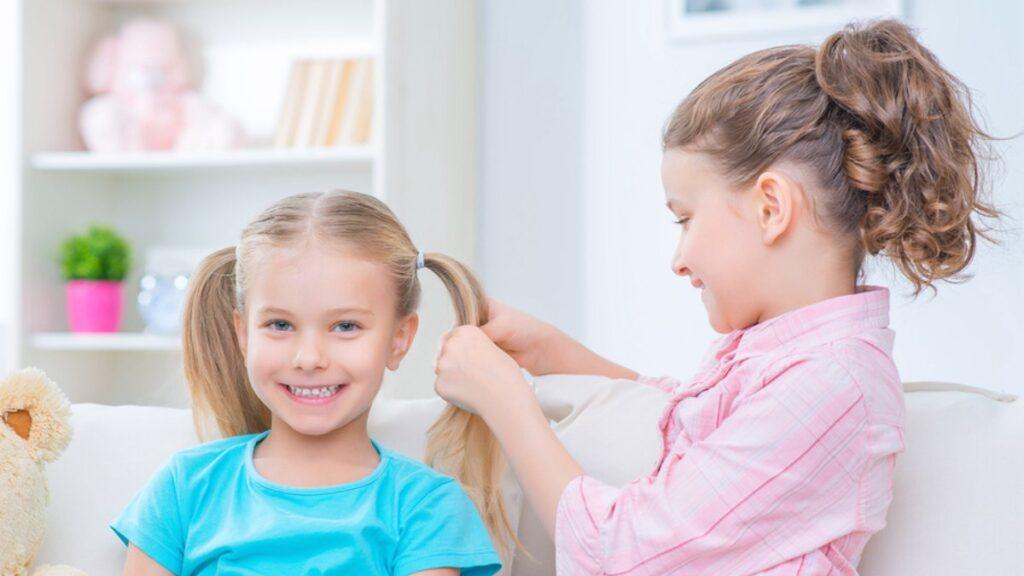 Little girls doing hair.