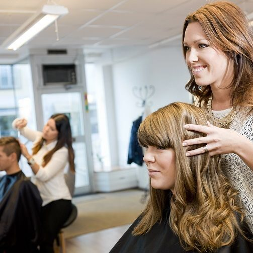 Woman styling her clients hair.