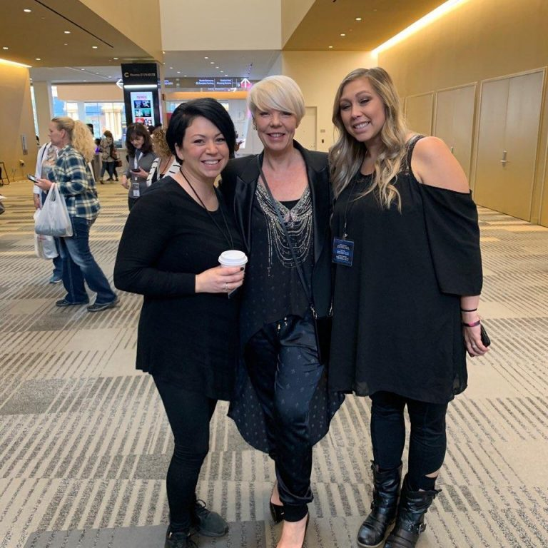 Tabitha Coffey with two cosmetology students